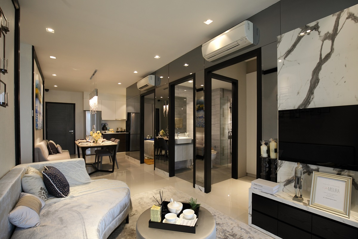 showing the living and dining area of a two bedroom apartment