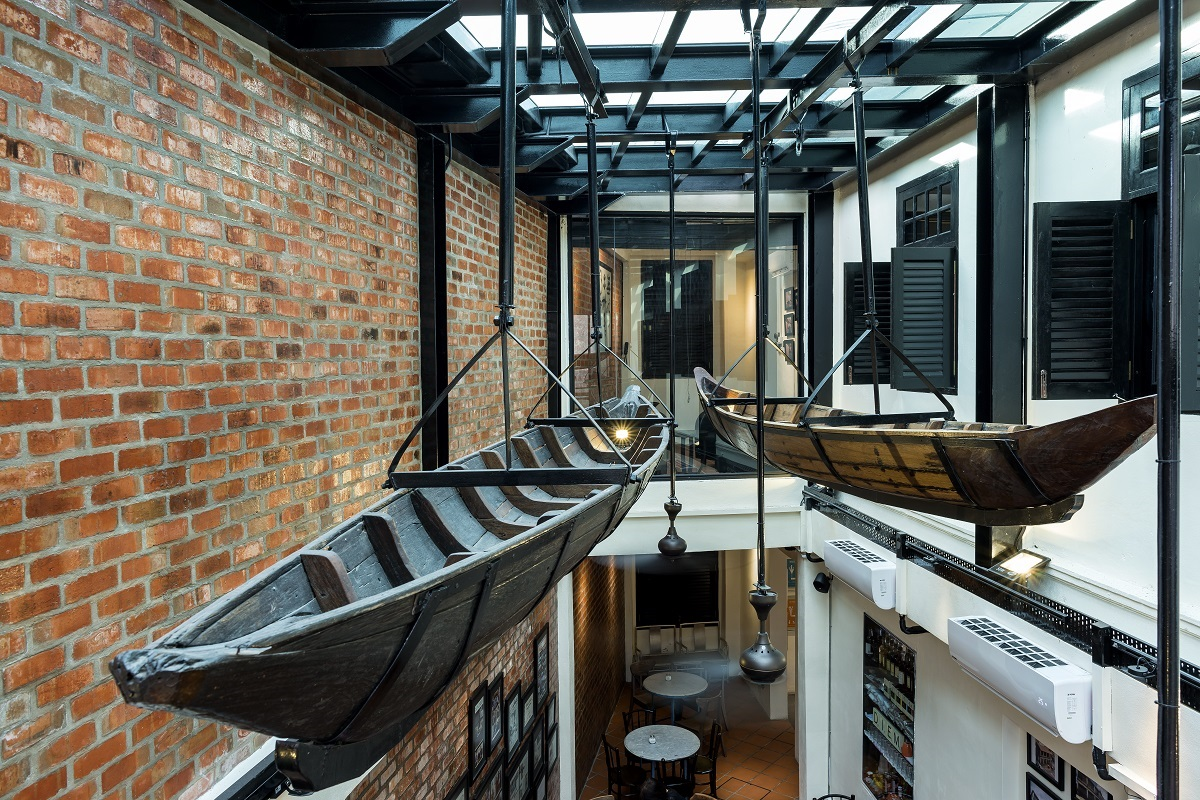 Ninety year old traditional boats suspended from the glass roof are one of the main features of the interior.