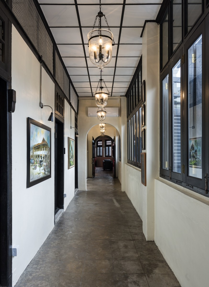 The corridor of the old prison cells that connects the Tunku room with the China room.