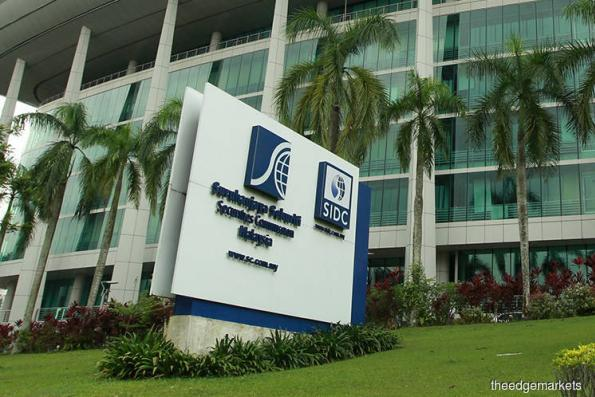 Securities Commission investigating Deloitte, KPMG over 1MDB scandal